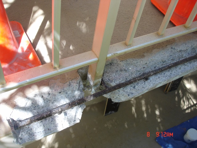 Concrete failed around railing posts.  SCB&R can install railings in a way that prevents this problem.