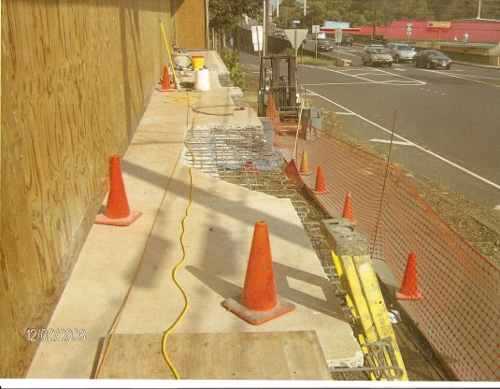 Repair of concrete at Maui Community Clinic.